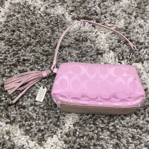 Pink Coach wristlet with tassel
